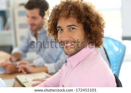 Cheerful man in office attending work meeting