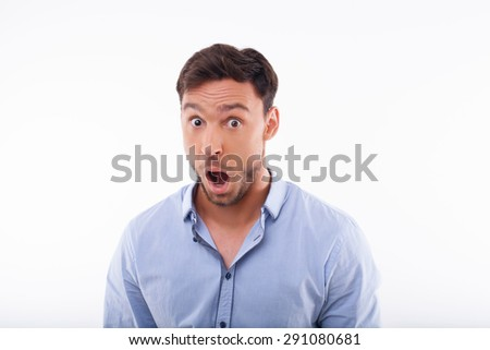 Cheerful man is shocking. His eyes and mouth are wide open. Isolated on a white background - stock photo