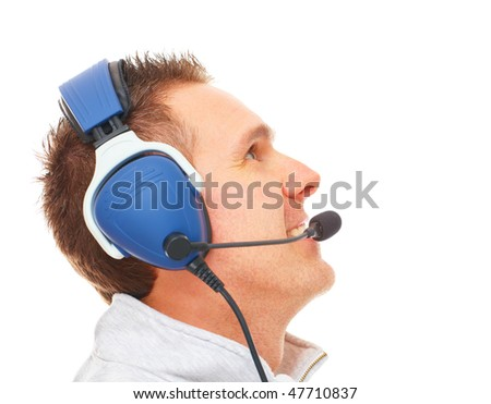 Cheerful man pilot with headset used in aircraft looking upwards aside isolated on white. Similar headphones are used in communication image also suits for radio TV sport commentator, controller. - stock photo