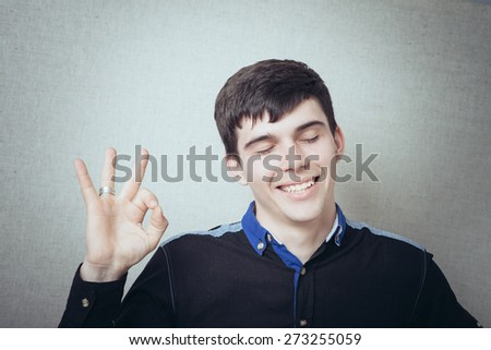 cheerful man showing everything is OK - stock photo
