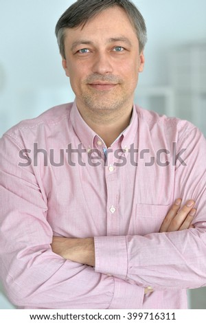 cheerful man standing on a gray background - stock photo