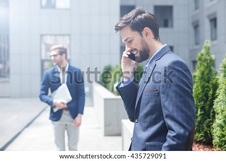 Cheerful man using modern technology for communication - stock photo
