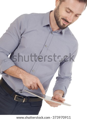 Cheerful man with a digital tablet - stock photo