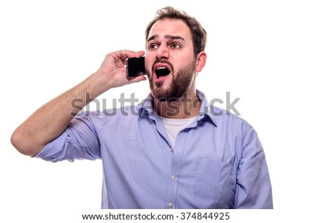 Cheerful man with beard singing with his cell phone to his ear - stock photo