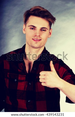 Cheerful man with thumbs up. - stock photo
