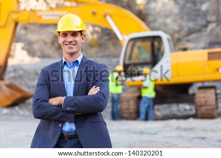 cheerful manager with arms crossed - stock photo