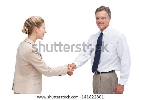 Cheerful mature businessman shaking hands and looking at the camera - stock photo