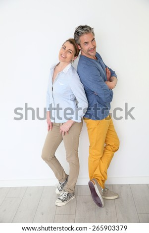 Cheerful mature couple on white background - stock photo