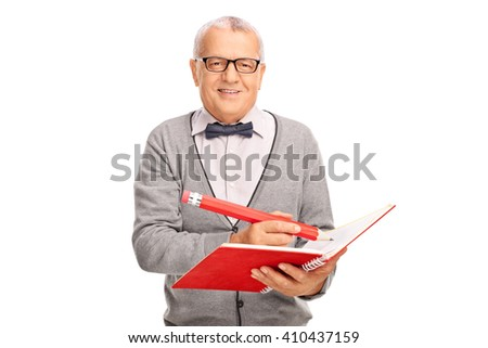 Cheerful mature teacher writing something in a notebook with a huge pencil isolated on white background - stock photo
