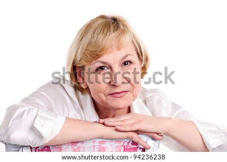 Cheerful mature woman over white background - stock photo