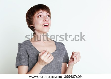 Cheerful middle age woman is excited because of something.Excited woman - stock photo