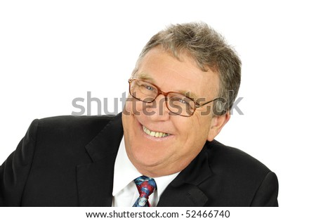 Cheerful middle aged businessman smiling looking to camera.