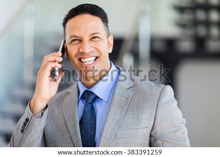 cheerful middle aged businessman talking on mobile phone - stock photo