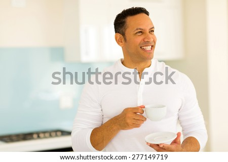 cheerful middle aged man drinking coffee at home - stock photo