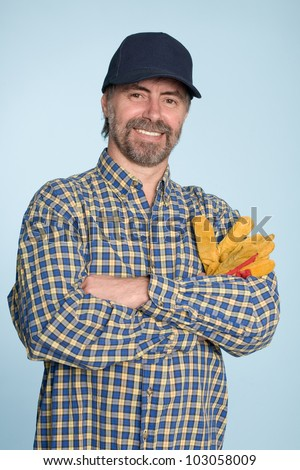 Cheerful middle aged man in a baseball cap. - stock photo