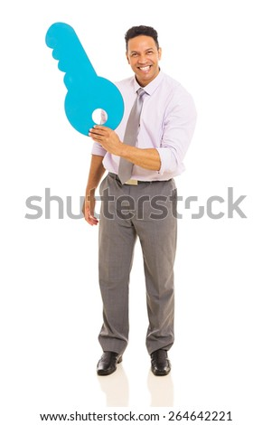 cheerful middle aged man showing blue paper key - stock photo