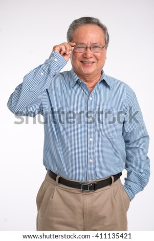 Cheerful middle-aged man smiling and adjusting glasses