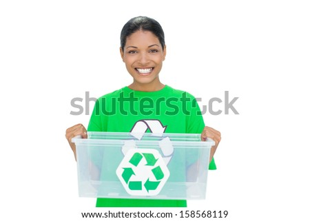 Cheerful model wearing recycling tshirt holding plastic box on white background