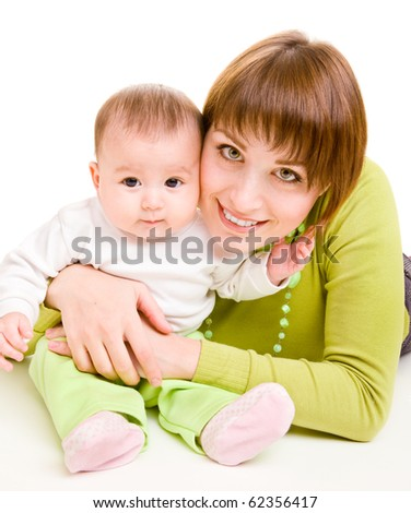 Cheerful mother embracing infant - stock photo