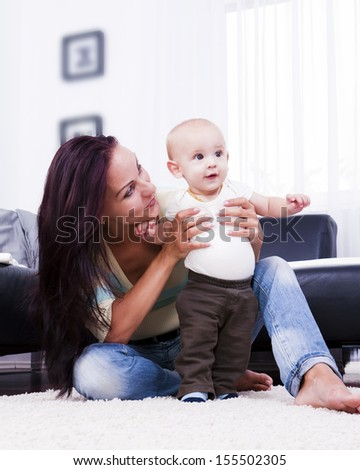 Cheerful mother of the boy child. - stock photo