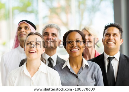 cheerful multicultural business group looking up - stock photo