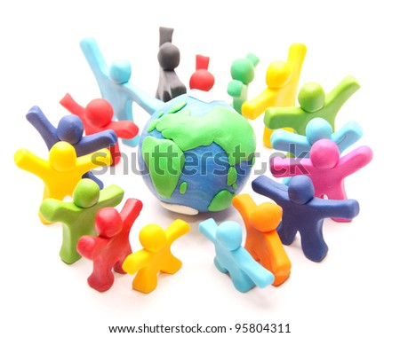 cheerful palsticine people standing around their world to protect it - stock photo