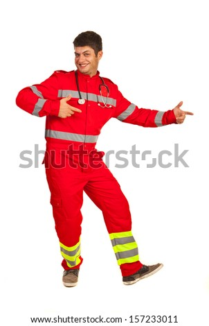 Cheerful paramedic pointing to copy space isolated on white background - stock photo