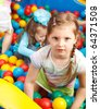 Cheerful preschoolers in a pool with colorful balls - stock photo