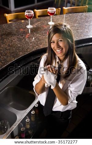 Cheerful pretty female bartender - stock photo