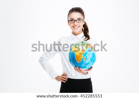 Cheerful pretty young businesswoman smiling and holding globe over white background