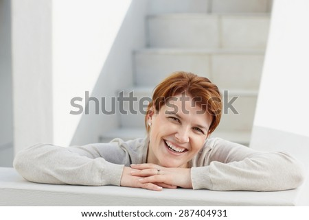 Cheerful red haired woman