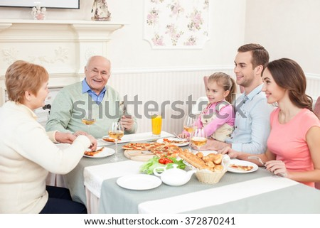 Cheerful relatives are dining together with joy - stock photo