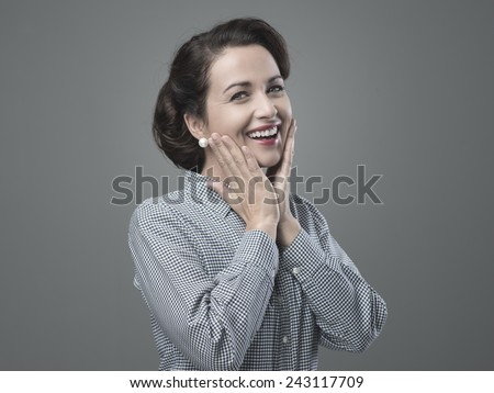 Cheerful 1950s woman feeling awesome and full of energy - stock photo