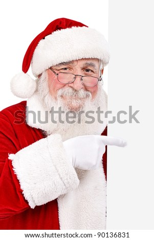cheerful Santa Claus pointing in white  blank banner, isolated on white background - stock photo