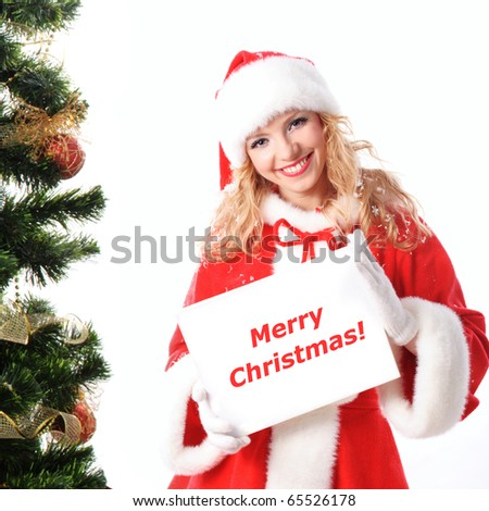 cheerful santa girl hold the blank placard with copy text. Christmas greetings card