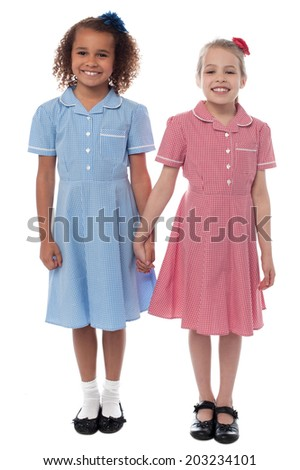 Cheerful school girls posing together, holding hands - stock photo