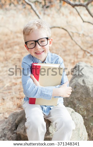 cheerful schoolboy in glasses studying, back to school concept - stock photo