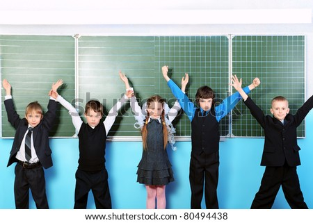 Cheerful schoolchildren at a classroom. Education.
