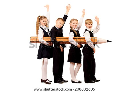 Cheerful schoolgirls and boys stand together and hold a huge pencil. Educational concept. Isolated over white. - stock photo