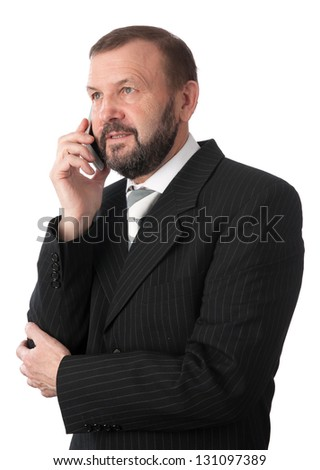 cheerful senior business man talking on a cell phone. Isolated on white - stock photo