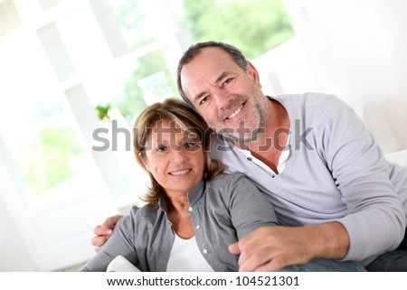 Cheerful senior couple enjoying being at home - stock photo