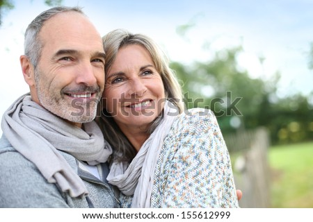 Cheerful senior couple enjoying peaceful nature - stock photo