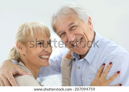 Cheerful senior couple laughing outloud - stock photo