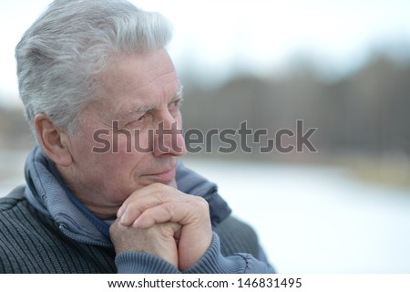 cheerful senior man to walk on the nature of the spring - stock photo
