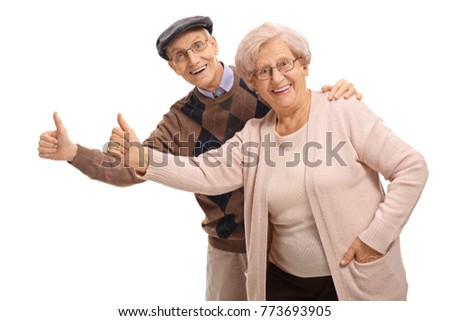 Cheerful seniors holding their thumbs up isolated on white background