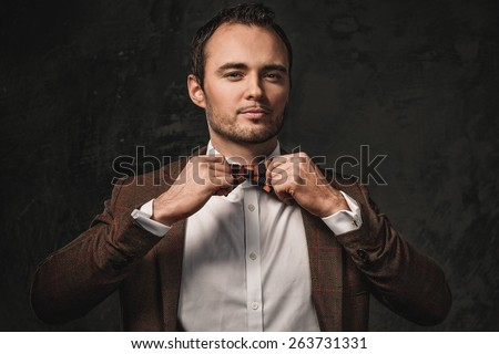 Cheerful sharp dressed fashionist wearing jacket and bow tie