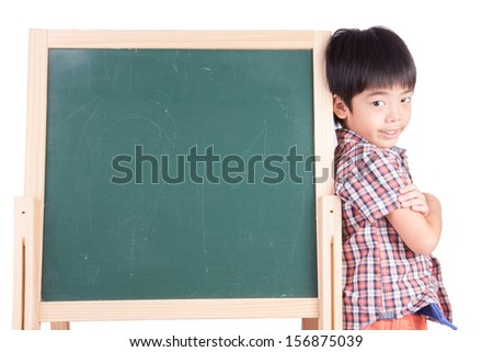 Cheerful smiling boy with blackboard on white background - stock photo