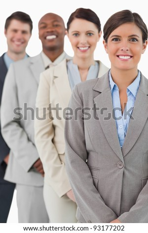 Cheerful smiling businessteam standing together against a white background