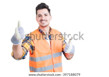 Cheerful smiling engineer showing thumbs up with both hands on white studio background - stock photo