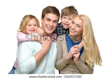 Cheerful smiling family of four enjoying time together. Children riding piggyback on parents. Isolated on white background. Concept for happy family - stock photo